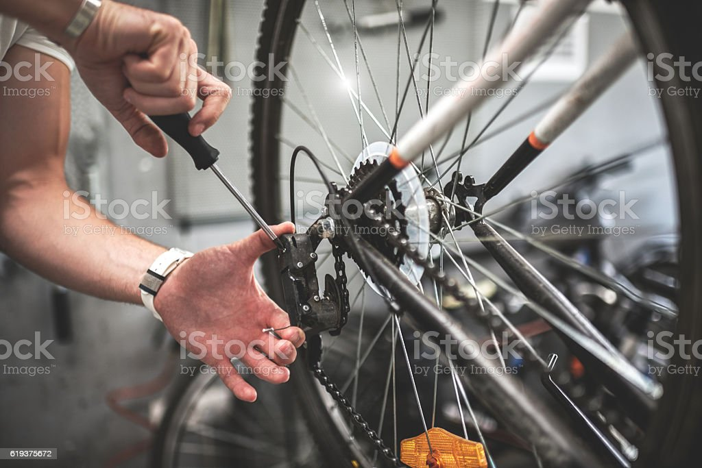 Fixing the bicycle wheel stock photo