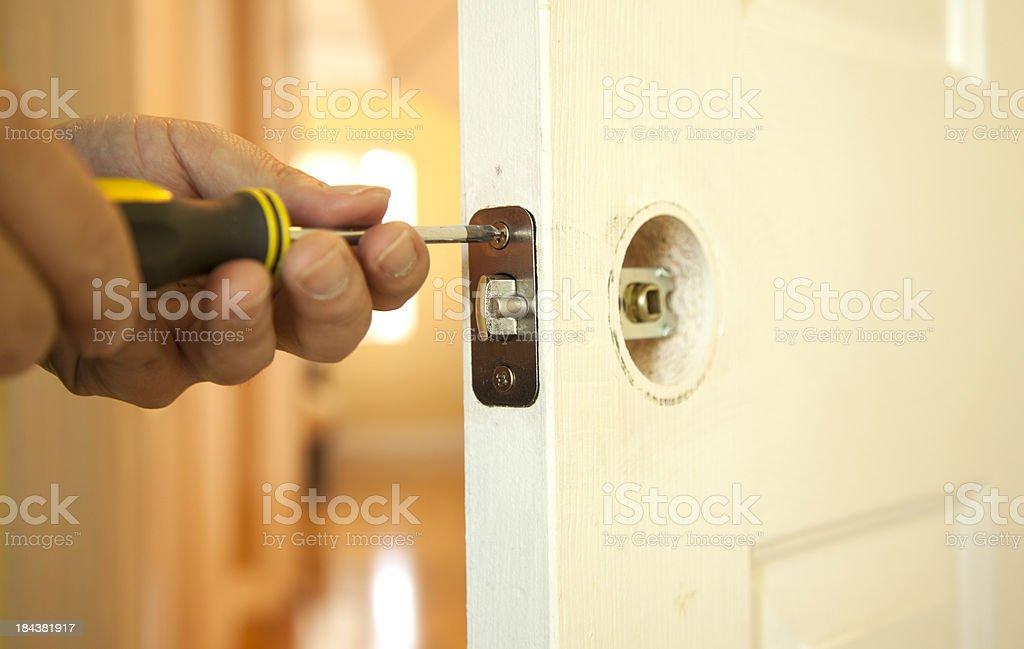 Fixing the door royalty-free stock photo