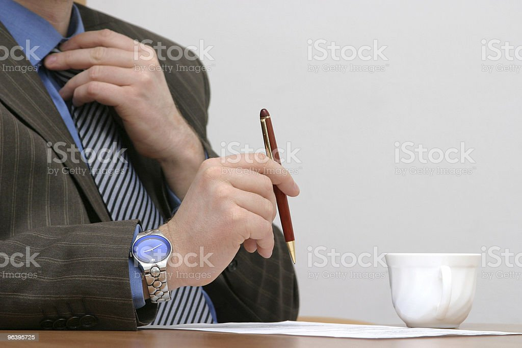 Fixing  tie before signing the contract royalty-free stock photo