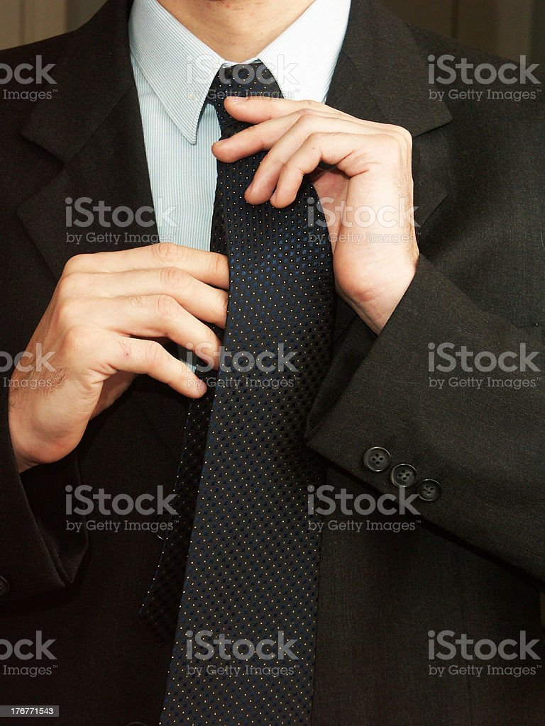 Fixing tie royalty-free stock photo