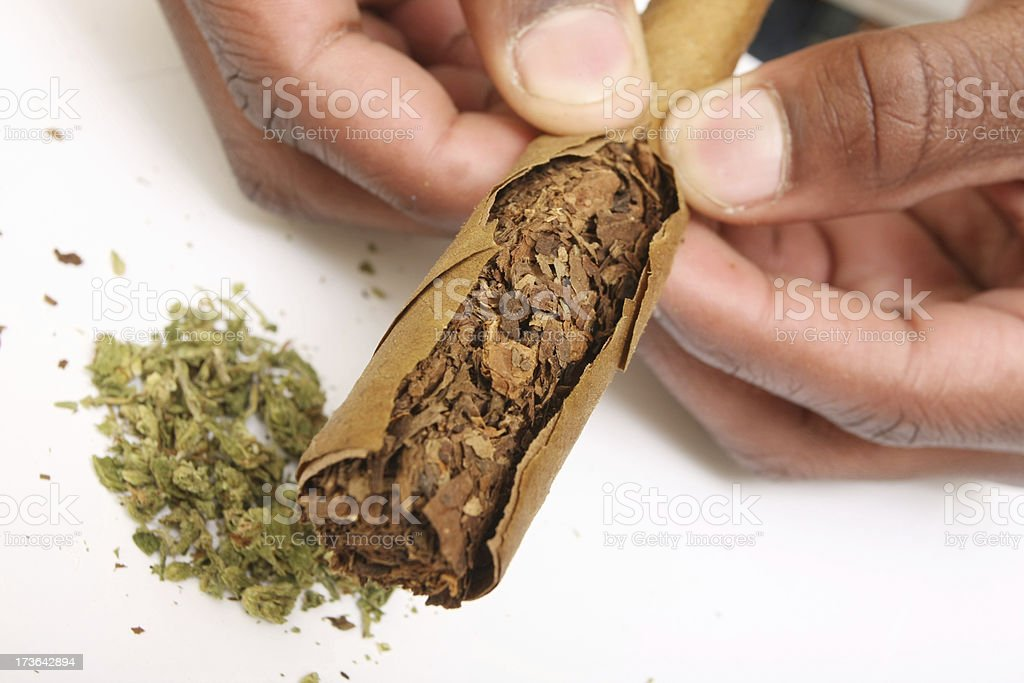 fixing up a blunt stock photo