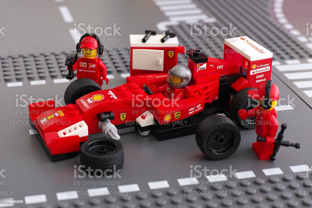 Fixing wheels of Ferrari F14 T by Lego Speed Champions stock photo