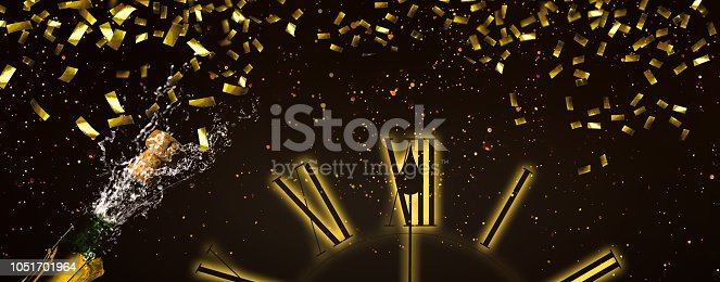 1051699126 istock photo fizzing champagne and raining gold confetti at midnight 1051701964