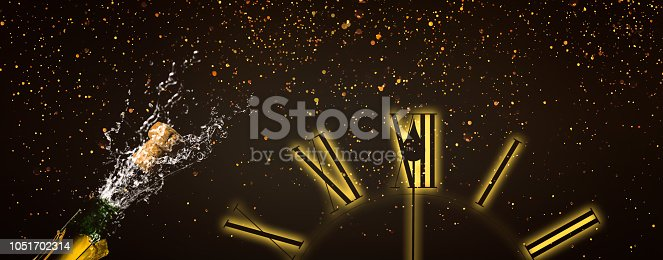 1051699126 istock photo fizzing champagne at the midnight hour 1051702314