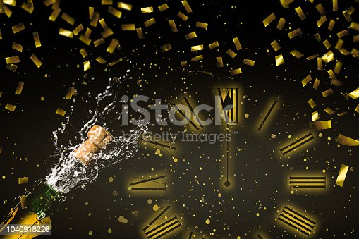 1051699126 istock photo fizzing champagne midnight at new years eve 1040918226