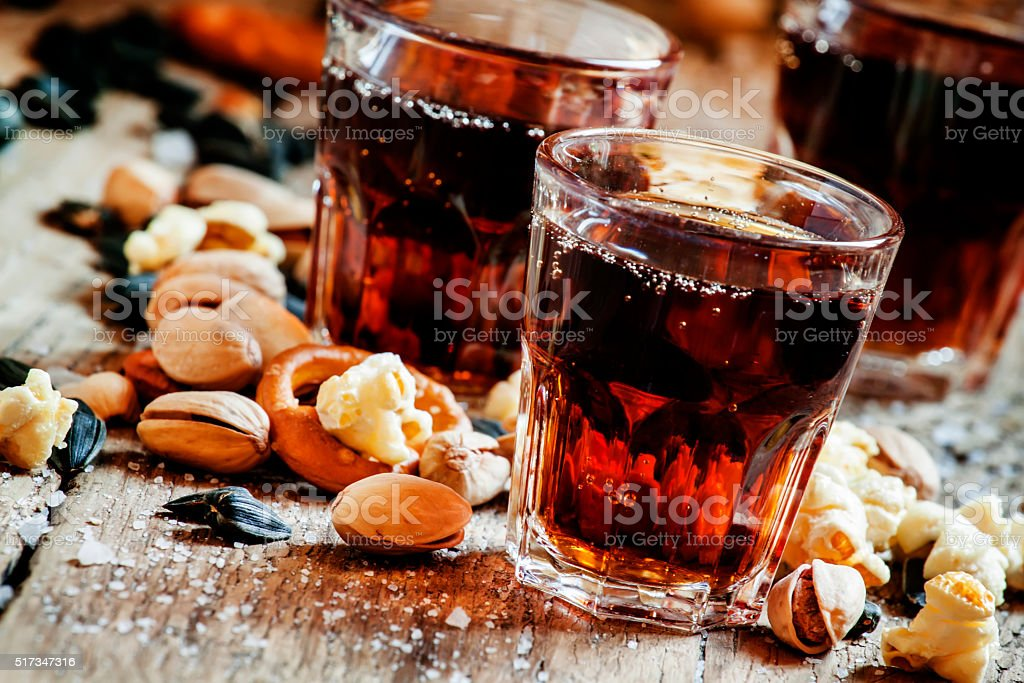 Fizzy drink glasses, sweet and savory snacks stock photo