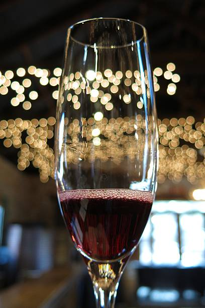 fizzy red wine in champagne flute stock photo
