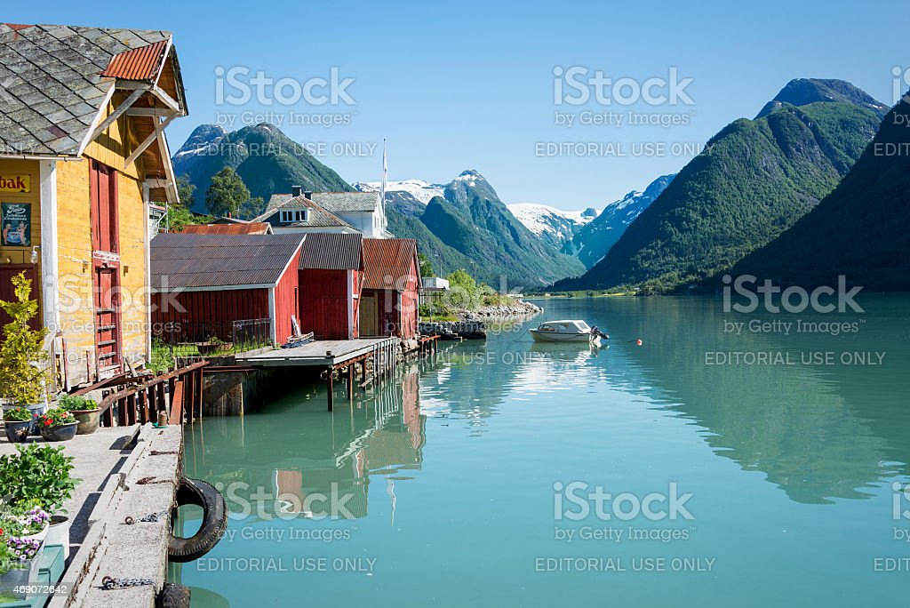Fjord, mountains, boathouse and reflection in Norway stock photo