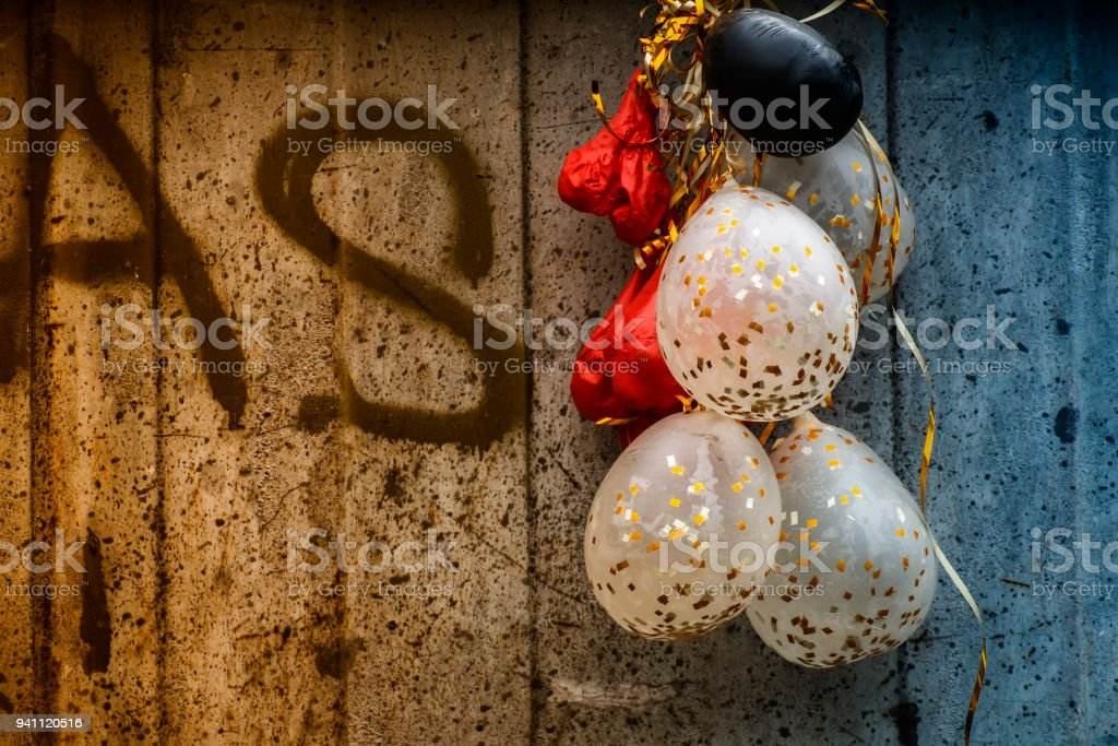 Flabby festive balloons on a grunge background stock photo