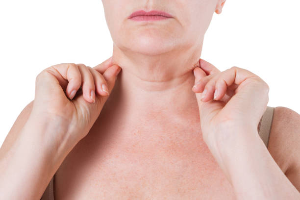 Flabby skin on the neck of an elderly woman isolated on white background stock photo