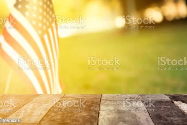 Flag afternoon sun along neighborhood road or meadow with blank table picture id926010318?b=1&k=6&m=926010318&s=612x612&h=tkszv63j7ude8lzenjesbx0ybshiijlchkphiqw4isa=