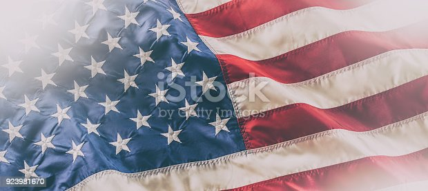 istock USA flag. American flag. American flag blowing in the wind 923981670