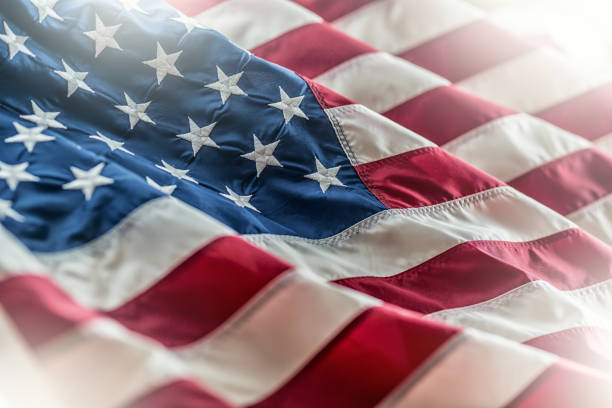 usa flag. american flag. american flag blowing in the wind - american flag stock pictures, royalty-free photos & images