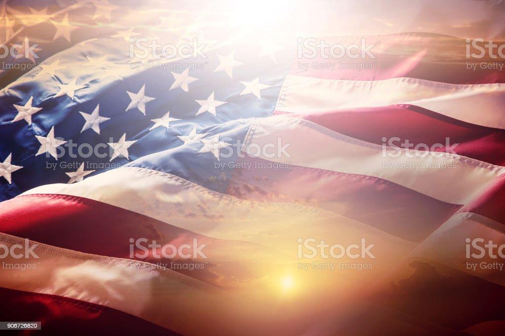USA flag. American flag. American flag blowing wind at sunset or sunrise. Close-up - Zbiór zdjęć royalty-free (Amerykańska flaga)