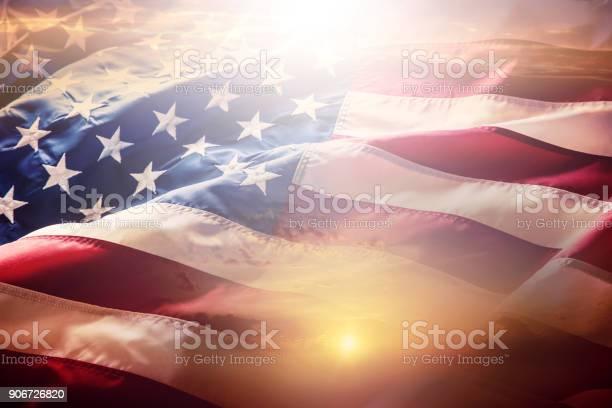 Flag american flag american flag blowing wind at sunset or sunrise picture id906726820?b=1&k=6&m=906726820&s=612x612&h=u4ywij9edu24bokfhv v35r lphzikos4o vmldiqeq=