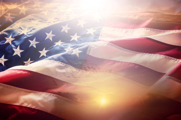USA flag. American flag. American flag blowing wind at sunset or sunrise. Close-up stock photo