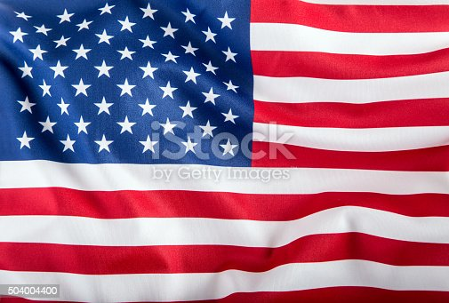 istock USA flag. American flag. American flag blowing wind. Close-up. 504004400