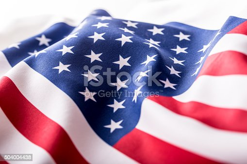 istock USA flag. American flag. American flag blowing wind. Close-up. 504004438