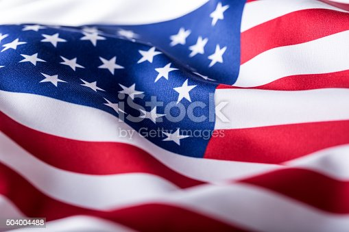 istock USA flag. American flag. American flag blowing wind. Close-up. 504004488