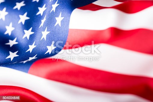 istock USA flag. American flag. American flag blowing wind. Close-up. 504004646