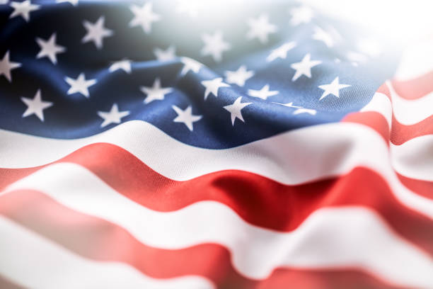 usa flag. american flag. american flag blowing wind. close-up. - us flag stok fotoğraflar ve resimler
