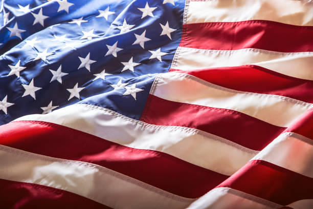 usa flag. american flag. american flag blowing wind. close-up. studio shot - usa flag stock photos and pictures