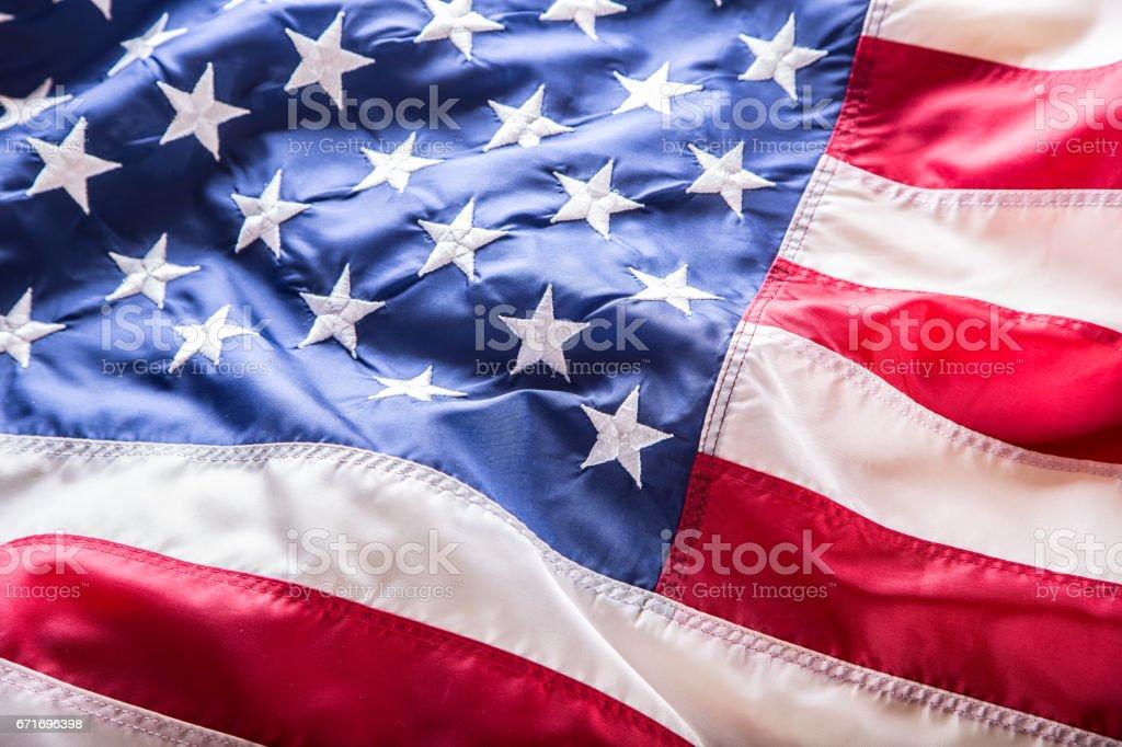 USA flag. American flag. American flag blowing wind. Close-up. Studio shot stock photo
