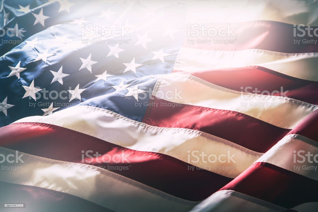 USA flag. American flag. American flag blowing wind. Close-up. Studio shot stock photo