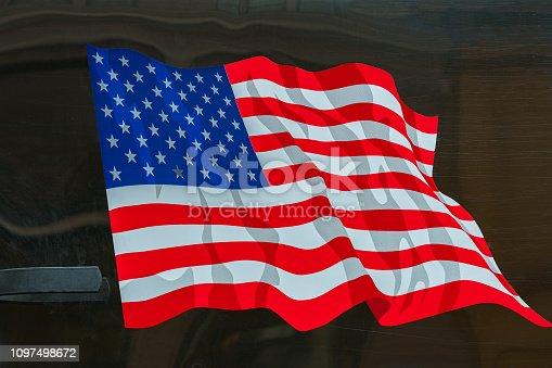 istock USA flag. American flag. American flag blowing wind 1097498672