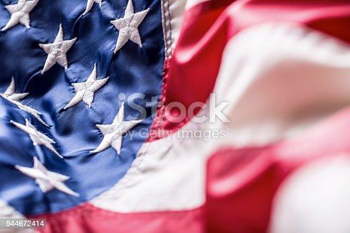 istock USA flag. American flag. American flag blowing wind. 544672414