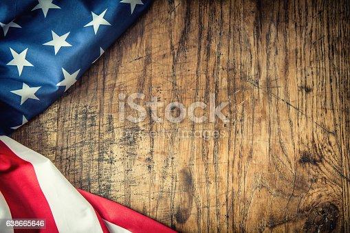 istock USA flag. American flag. American flag freely lying on table. 638665646