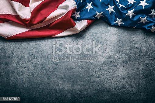 545427552 istock photo USA flag. American flag freely lying on concrete background. 545427552