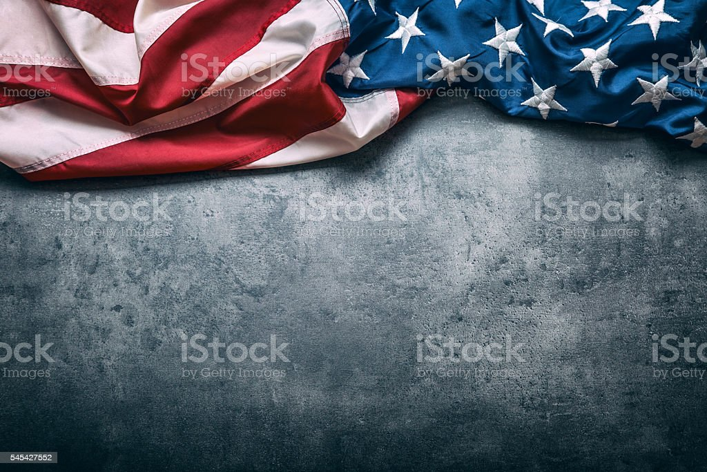 USA flag. American flag freely lying on concrete background. stock photo