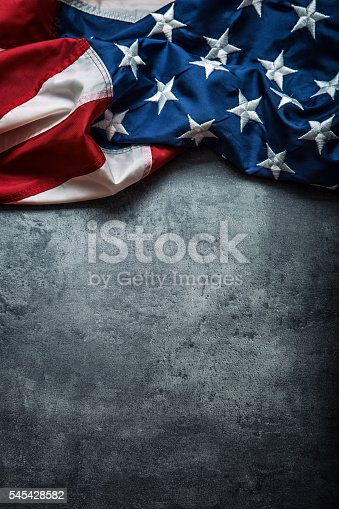 istock USA flag. American flag freely lying on concrete background. 545428582