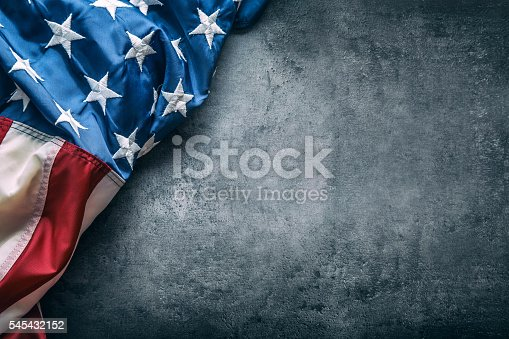 istock USA flag. American flag freely lying on concrete background. 545432152