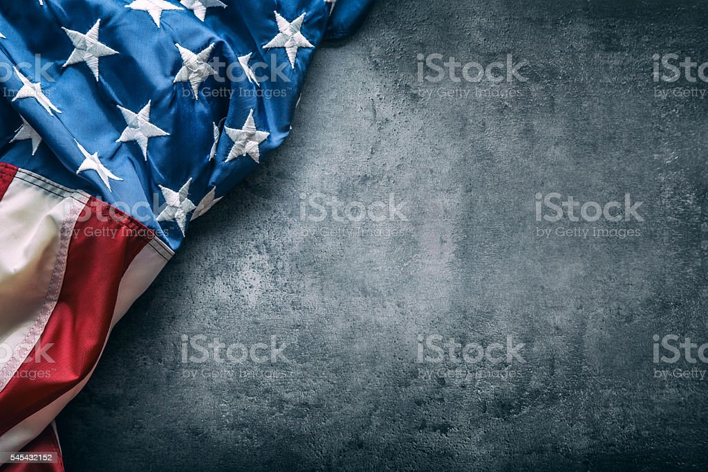 USA flag. American flag freely lying on concrete background. – Foto