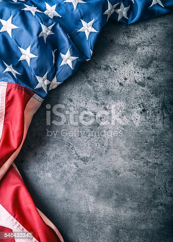 istock USA flag. American flag freely lying on concrete background. 545433342