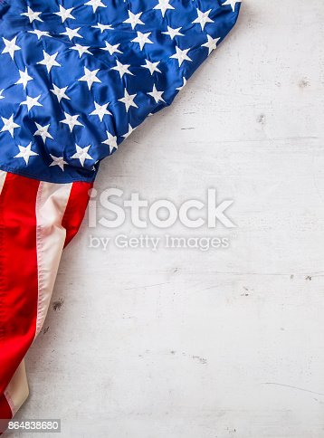 istock USA flag. American flag. Top of view American flag freely lying on white concrete background. Close-up Studio shot 864838680