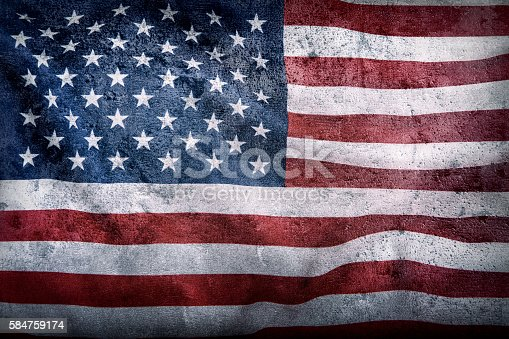 istock USA flag. American flagon concrete background. American flag blowing wind. 584759174