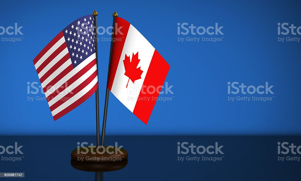 USA Flag And Canadian Desk Flags stock photo