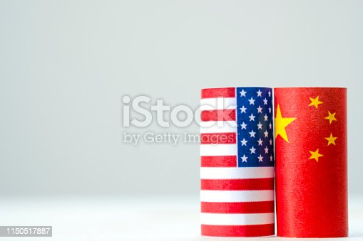 928696036 istock photo USA flag and China flag for tariff trade war and tech war between United States and China who conflict because of increase tax barrier of import and export product. Government politic and business. 1150517887