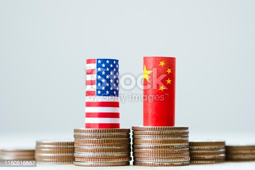 928696036 istock photo USA flag and China flag on coins stacking graph for tariff trade war between United States and China who conflict because of increase tax barrier of import and export product. Government and business. 1150516857