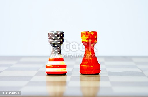 istock USA flag and China flag print screen on chess with white background.It is symbol of tariff trade war tax barrier between United States of America and China.-Image. 1163548566