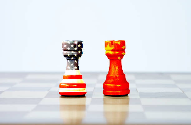 USA flag and China flag print screen on chess with white background.It is symbol of tariff trade war tax barrier between United States of America and China.-Image. USA flag and China flag print screen on chess with white background.It is symbol of tariff trade war tax barrier between United States of America and China.-Image. trade war stock pictures, royalty-free photos & images