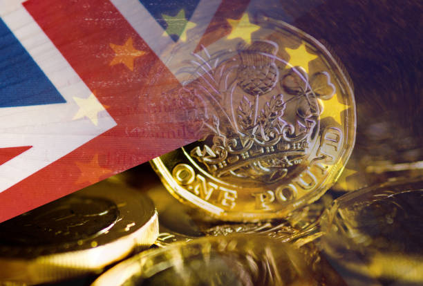 UK flag and coin stock photo