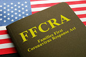 istock USA flag and families first coronavirus response act FFCRA law. 1220581053