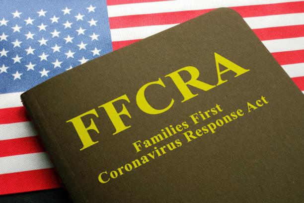 USA flag and families first coronavirus response act FFCRA law. stock photo