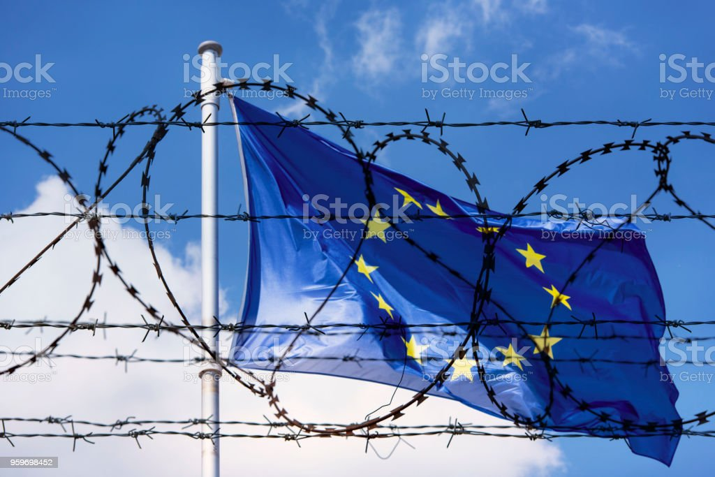 EU Flag and fence with barbed Wire concept Picture stock photo