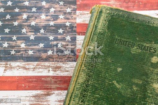 1034955096 istock photo USA flag and history book 913876858