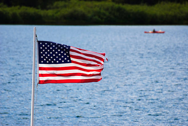 USA Flag and Lake stock photo